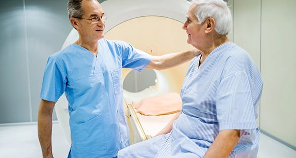 Mature radiologist talking to senior patient