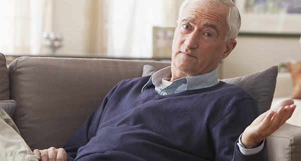 Senior man sitting on sofa