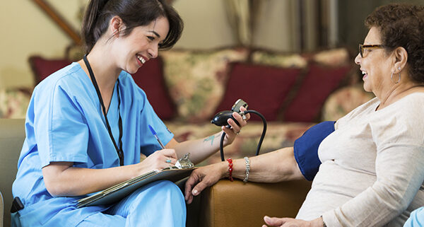 Woman giving transitional care services for patient