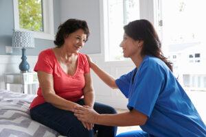 caregiver comforting senior with behaviors of Alzheimer's